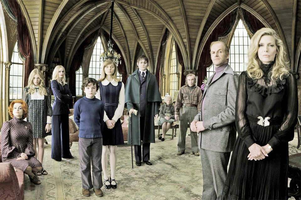 Photo - From left, Helena Bonham Carter appears as Dr. Julia Hoffman, Chloe Grace Moretz as Carolyn Stoddard, Eva Green as Angelique Bouchard, Gulliver McGrath as David Collins, Bella Heathcote as Victoria Winters, Johnny Depp as Barnabas Collins, Ray Shirley as Mrs. Johnson, Jackie Earle Haley as Willie Loomis, Jonny Lee Miller as Roger Collins, and Michelle Pfeiffer as Elizabeth Collins Stoddard in Warner Bros. Pictures' and Village Roadshow Pictures'