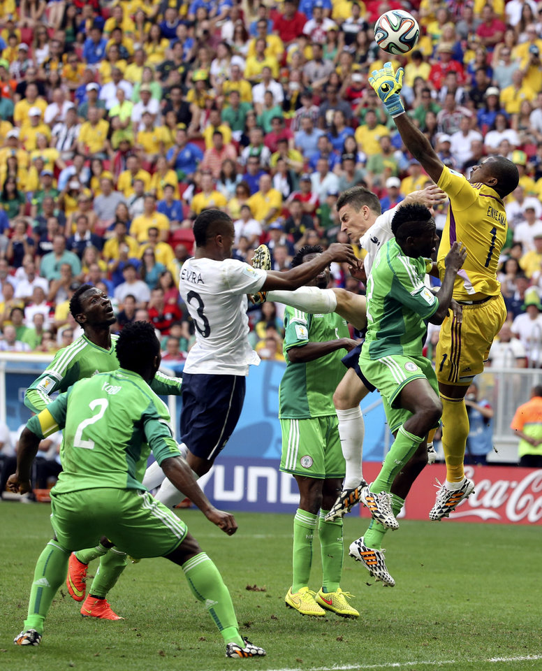 Photo - Nigeria's goalkeeper Vincent Enyeama fails to gather a cross from which France's Paul Pogba scored the opening goal during the World Cup round of 16 soccer match between France and Nigeria at the Estadio Nacional in Brasilia, Brazil, Monday, June 30, 2014. (AP Photo/David Vincent)
