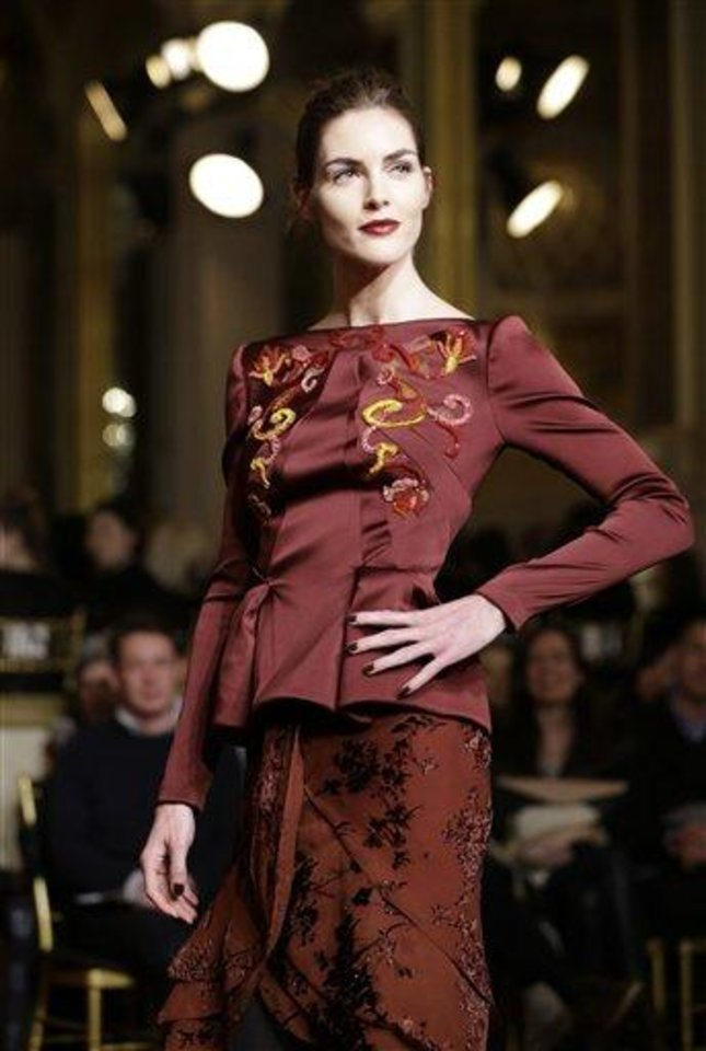 Photo - A model pauses during the Zac Posen Fall 2013 runway show at Fashion Week at the Plaza in New York, Sunday, Feb. 10, 2013.  (AP Photo/Kathy Willens)