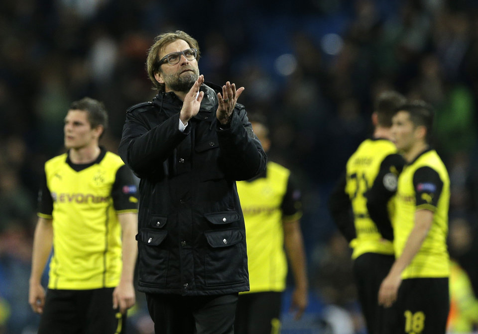 Photo - Dortmund head coach Juergen Klopp waves to Dormund supporters at the end of the Champions League quarterfinal first leg soccer match between Real Madrid and Borussia Dortmund at the Santiago Bernabeu   stadium in Madrid, Spain, Wednesday April 2, 2014. (AP Photo/Paul White)