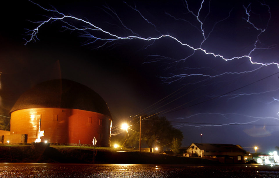 Lightning fills the sky over the Round Barn in Arcadia, Okla., Sunday, April 26, 2009. Photo by Sarah Phipps, The Oklahoman