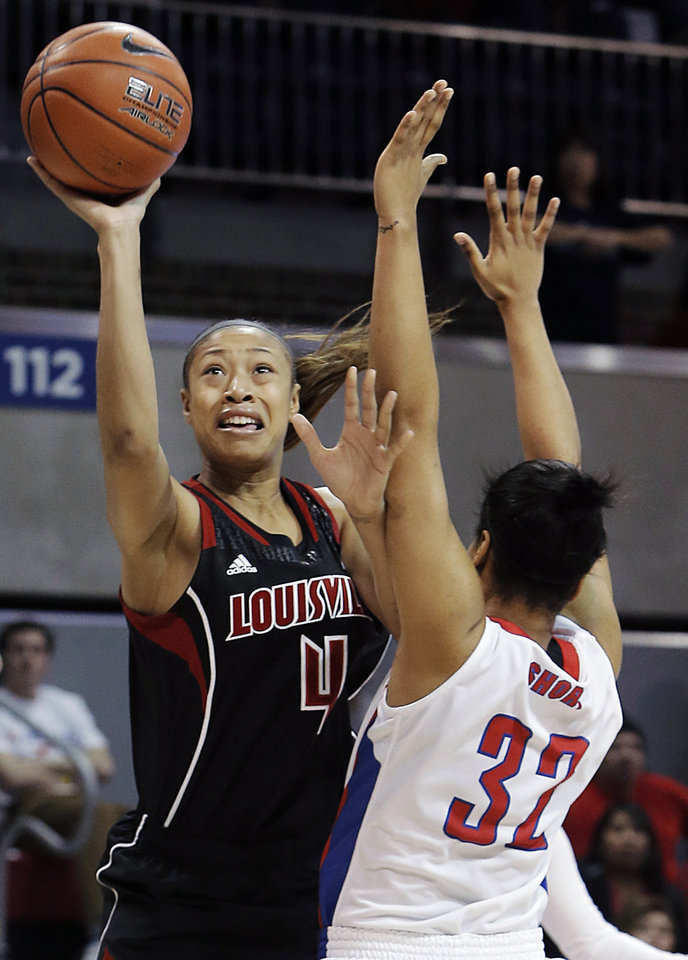 Photo - Louisville guard Antonita Slaughter (4) attempts a shot as SMU Raven Short (32) defends in the first half of an NCAA women's college basketball game, Sunday, Jan. 19, 2014, in Dallas. Louisville won 81-66. (AP Photo/Brandon Wade)