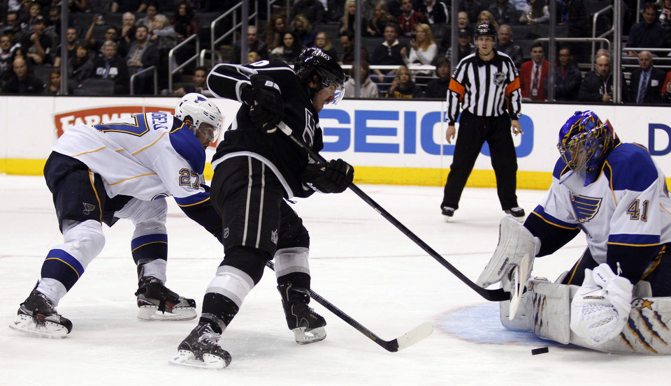 Photo - St. Louis Blues goalie Jaroslav Halak (41), of the Czech Republic blocks a shot by Los Angeles Kings center Mike Richards (10) with Blues defenseman Alex Pietrangelo (27) defending during the second period of an NHL hockey game Tuesday, March 5, 2013, in Los Angeles.  (AP Photo/Alex Gallardo)