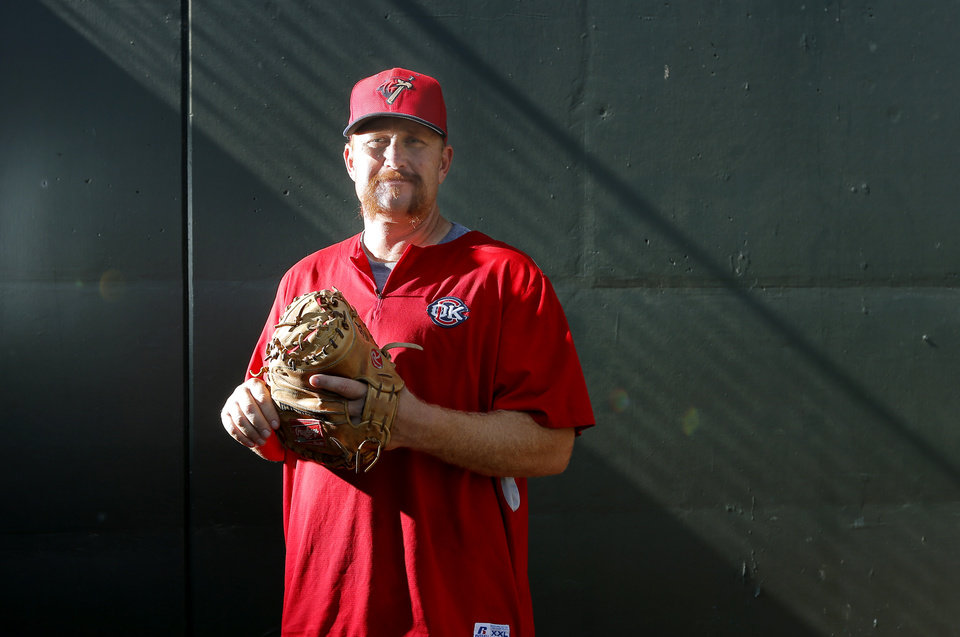 Photo - Oklahoma City's bullpen catcher/instructor Jeff Murphy poses for a picture at the in Oklahoma City, Thursday, Aug. 7, 2014. Photo by Sarah Phipps, The Oklahoman