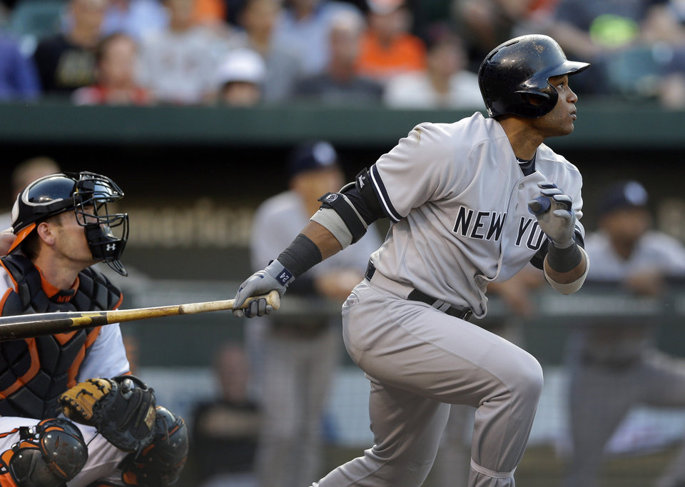 Photo - New York Yankees' Robinson Cano watches his solo home run in the first inning of a baseball game against the Baltimore Orioles in Baltimore, Monday, May 20, 2013. (AP Photo/Patrick Semansky)