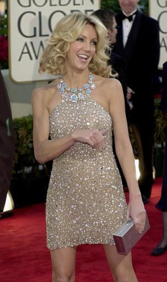 Actress Heather Locklear arrives at the 59th Annual Golden Globe Awards in Beverly Hills, Calif., Sunday, Jan. 20, 2002. Locklear is nominated for best actress in a television series comedy/musical for her role in  Spin City.  (AP Photo/Kevork Djansezian)