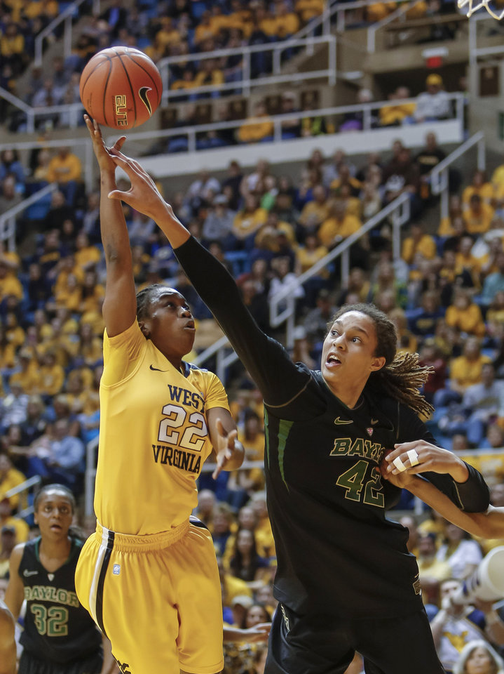 Photo - Baylor's Brittney Griner (42) blocks the shot of West Virginia's Linda Stepney (22) during the second half of an NCAA college basketball game at WVU Coliseum in Morgantown, W.Va., on Saturday, March 2, 2013. Baylor won 80-49. (AP Photo/David Smith)