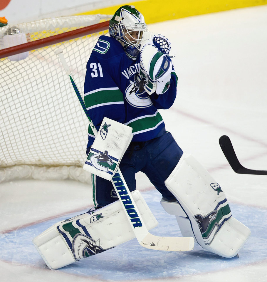 Photo - Vancouver Canucks' goalie Eddie Lack, of Sweden, stops a Buffalo Sabres shot during second period NHL hockey action in Vancouver, British Columbia, on Sunday March 23, 2014. (AP Photo/The Canadian Press, Darryl Dyck)