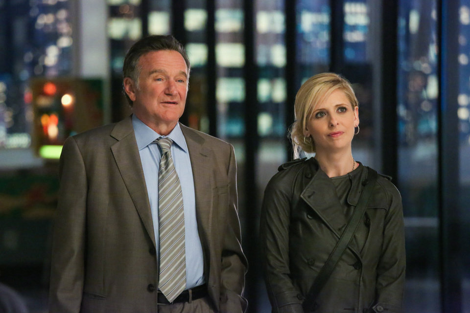 "Photo - This publicity image released by CBS shows Robin Williams, left, and Sarah Michelle Gellar in a scene from the pilot episode of ""The Crazy Ones,"" a new CBS comedy premiering Thursday, Sept. 26 at 9 p.m. EST. (AP Photo/CBS, Richard Cartwright)"