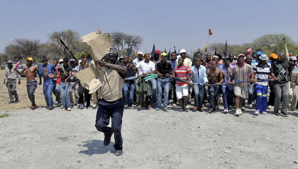Striking mineworkers take part in a demonstration in Rustenburg, South Africa, Saturday Oct. 6 2012. A leader for striking miners at Anglo American Platinum mines in South Africa said they would make it difficult for the company to hire new miners after the company fired some 12,000 striking workers earlier this week. (AP Photo)