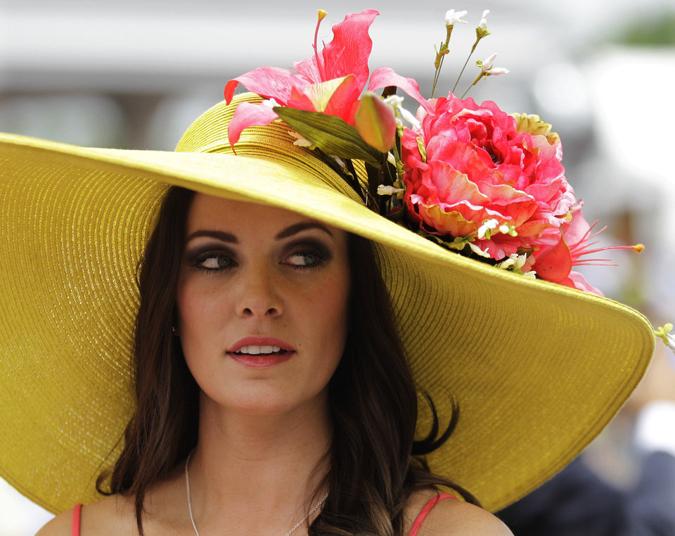 Photo - Tamara Sorrell, from Austin, Tx., wears a fancy hat in the paddocks before the 138th Kentucky Derby horse race at Churchill Downs Saturday, May 5, 2012, in Louisville, Ky. (AP Photo/Mark Humphrey)  Mark Humphrey - AP