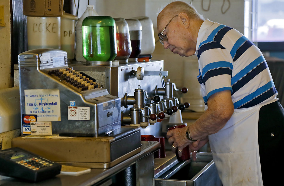 Owner Johnny Ballard prepares drinks during the lunch hour at Ballard\'s Drive-In located in Pauls Valley, Okla. Monday, July 16, 2012. Photo by Chris Landsberger, The Oklahoman
