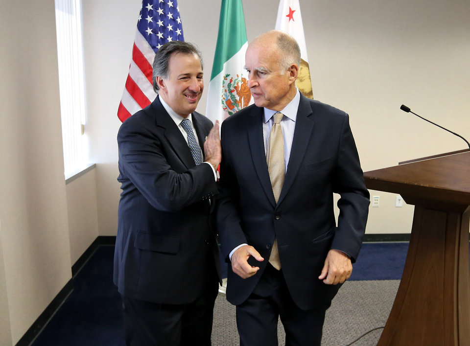 Photo - Gov. Jerry Brown, right, and Mexican Secretary of Foreign Affairs Jose Antonio Meade Kuribrena  leave a news conference after talking with reporters Wednesday, July 23, 2014, in Sacramento, Calif.  Brown and Meade attended a luncheon hosted by the California Chamber of Commerce, where they discussed Brown's upcoming visit to Mexico.(AP Photo/Rich Pedroncelli)