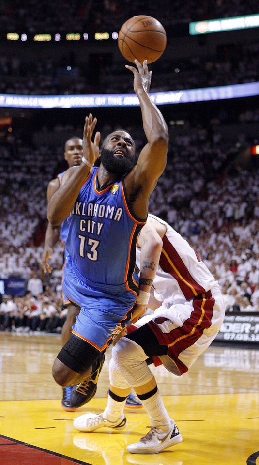 Oklahoma City\'s James Harden (13) drives to the basket as Miami\'s Mike Miller (13) defends during Game 5 of the NBA Finals between the Oklahoma City Thunder and the Miami Heat at American Airlines Arena, Thursday, June 21, 2012. Photo by Bryan Terry, The Oklahoman