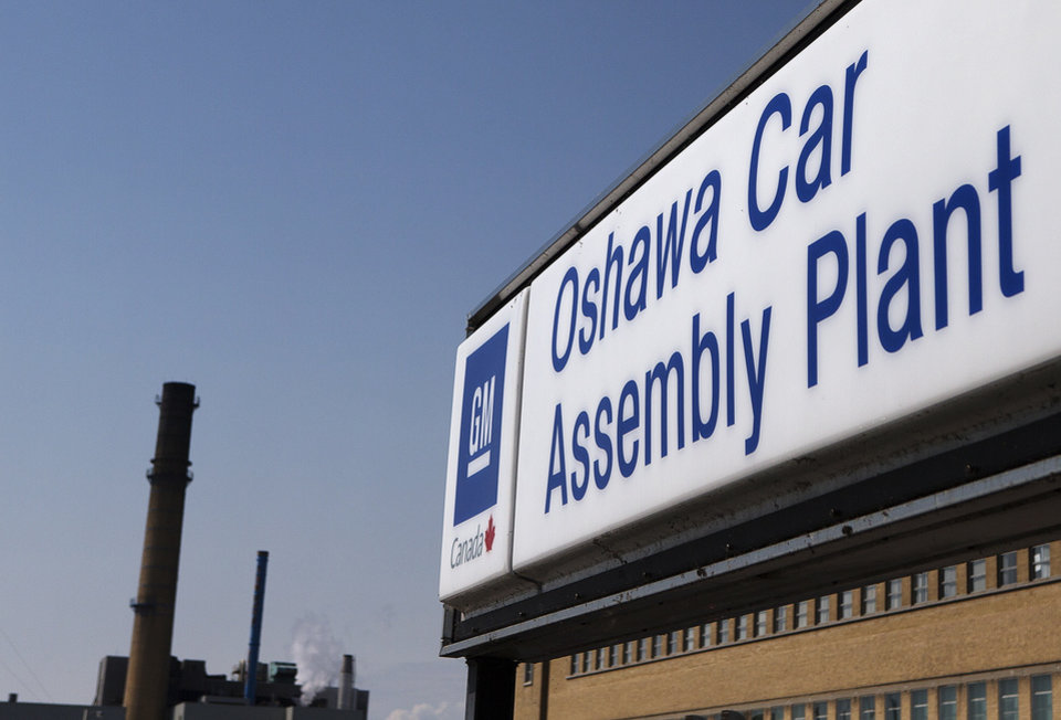 FILE - In this Monday, Sept. 17, 2012, file photo, a sign stands outside Oshawa's General Motors car assembly plant in Oshawa, Canada. General Motors says it has received $11 billion in credit lines from 35 financial institutions in 14 countries, boosting its available cash and credit to more than $42 billion. The company wouldn�t say specifically what it plans to do with the money. (AP Photo/The Canadian Press, Michelle Siu, File)