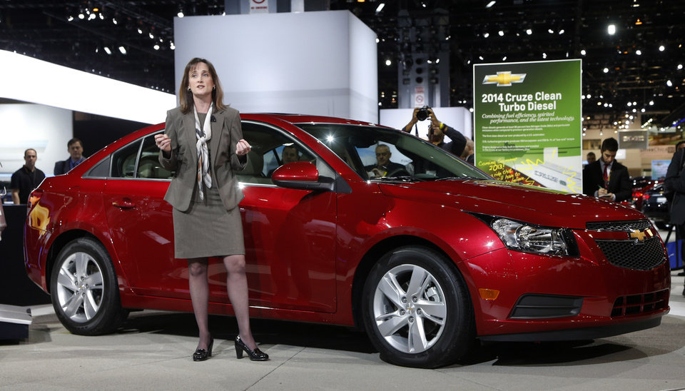 Photo - Cristi Landy, Marketing Director Chevrolet Small Cars unveils the 2014 Chevrolet Cruze Diesel at the Chicago Auto Show Thursday, Feb. 7, 2013, in Chicago. (AP Photo/Charles Rex Arbogast)