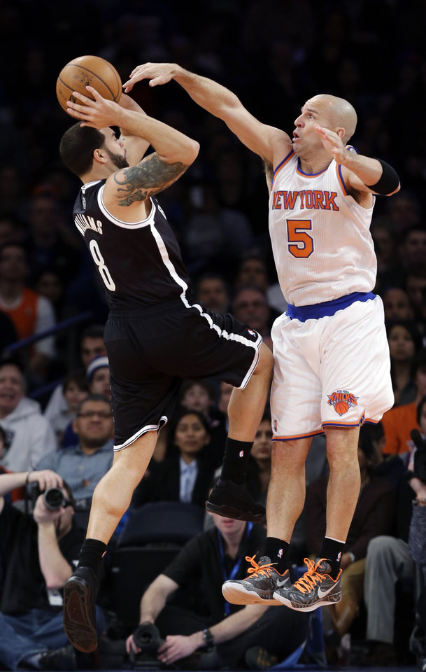 Brooklyn Nets guard Deron Williams (8) tries to shoot over New York Knicks guard Jason Kidd (5) in the first half of their NBA basketball game at Madison Square Garden in New York, Monday, Jan. 21, 2013. (AP Photo/Kathy Willens)