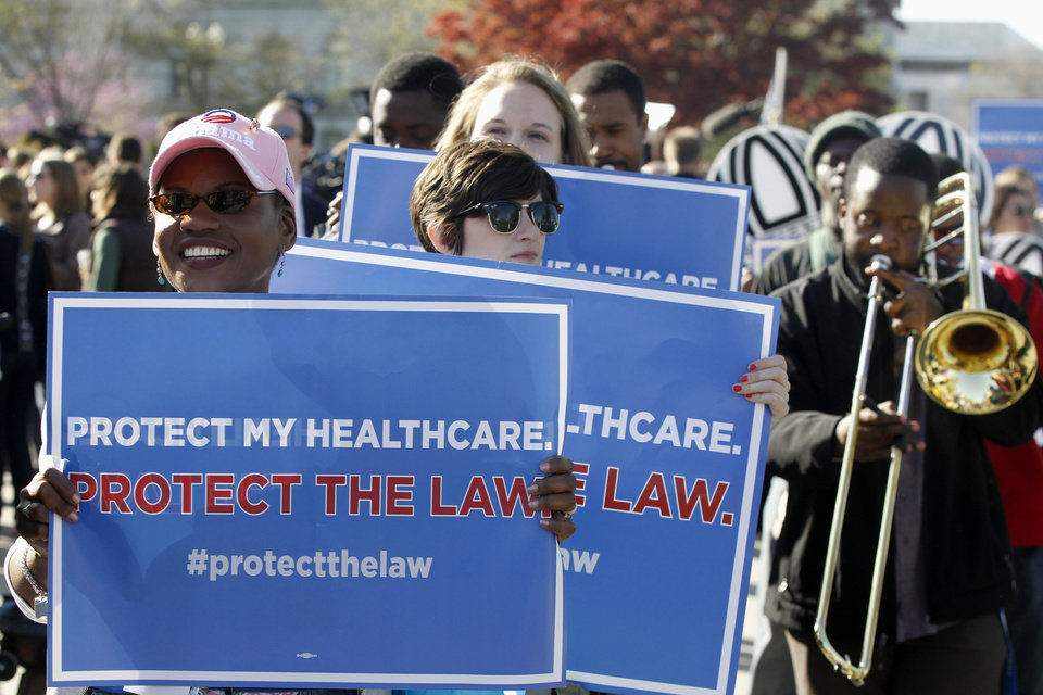 Supporters for the health care reform law signed by President Barack Obama rally in front of the Supreme Court in Washington, Monday, March 26, 2012, as the court begins three days of arguments on health care. (AP Photo/Charles Dharapak) ORG XMIT: DCCD110