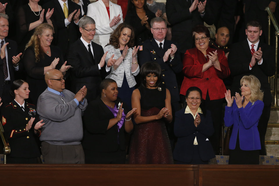 First lady Michelle Obama is applauded before President Barack Obama\'s State of the Union address during a joint session of Congress on Capitol Hill in Washington, Tuesday Feb. 12, 2013. Front row, from left are, Sgt. Sheena Adams, Nathaniel Pendelton, Cleopatra Cowley-Pendelton, Mrs. Obama, Menchu Sanchez and Jill Biden. (AP Photo/J. Scott Applewhite) ORG XMIT: CAP117