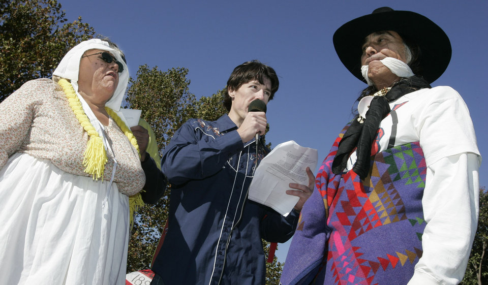 Photo - Glenda Deer of Shawnee, Dusty Dare of Norman and Richard Whitman of OKC re-enact the marriage of Miss Oklahoma territory and Mr Indian territory with Dare acting as minister during the Oklahoma Indians Survival Walk and Remembrance Ceremony Friday, Nov. 16, 2007 near the state Capitol. BY JACONNA AGURRE/THE OKLAHOMAN.