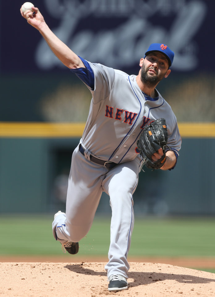 Photo - New York Mets starting pitcher Dillon Gee works against the Colorado Rockies in the first inning of a baseball game in Denver on Sunday, May 4, 2014. (AP Photo/David Zalubowski)