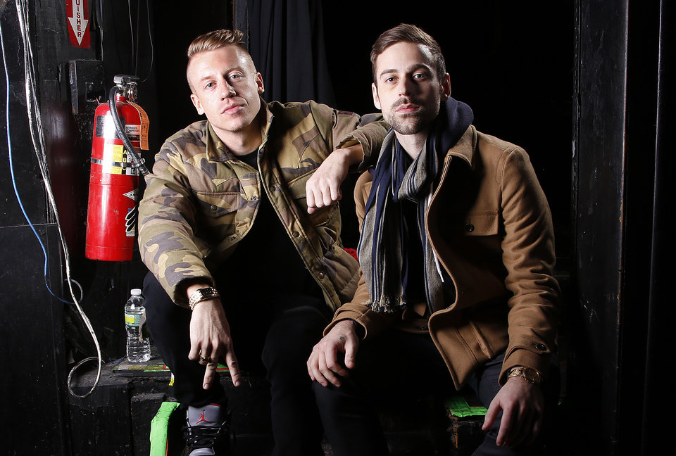 Photo - FILE - This Nov. 20, 2012, file photo, shows Ben Haggerty, better known by his stage name Macklemore, left, and his producer Ryan Lewis at Irving Plaza in New York. Newcomers Macklemore & Ryan Lewis will battle heavyweights Justin Timberlake and Taylor Swift for the top prize at the 2013 American Music Awards. (Photo by Carlo Allegri/Invision/AP, File)