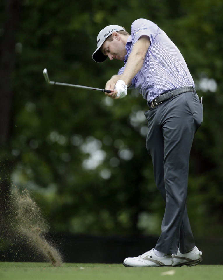 Photo - Brendon Todd hits his tee shot on the 11th hole during the first round of the PGA Championship golf tournament at Valhalla Golf Club on Thursday, Aug. 7, 2014, in Louisville, Ky. (AP Photo/Jeff Roberson)