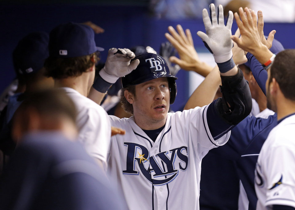 Photo - Tampa Bay Rays' Ryan Hanigan is congratulated on his three-run home run during the fifth inning of a baseball game against the Texas Rangers on Friday, April 4, 2014, in St. Petersburg, Fla. (AP Photo/Mike Carlson)