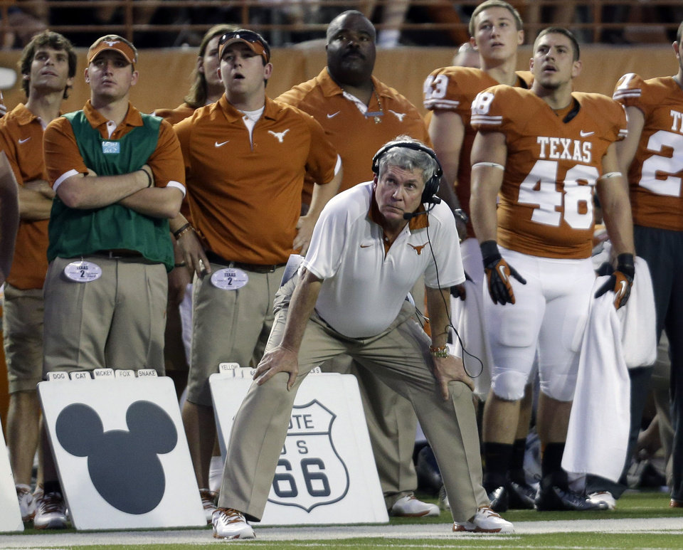 Texas coach Mack Brown stands next to symbols used for play calling during the first quarter of an NCAA college football game against New Mexico, Saturday, Sept. 8, 2012, in Austin, Texas. (AP Photo/Eric Gay) ORG XMIT: TXEG119