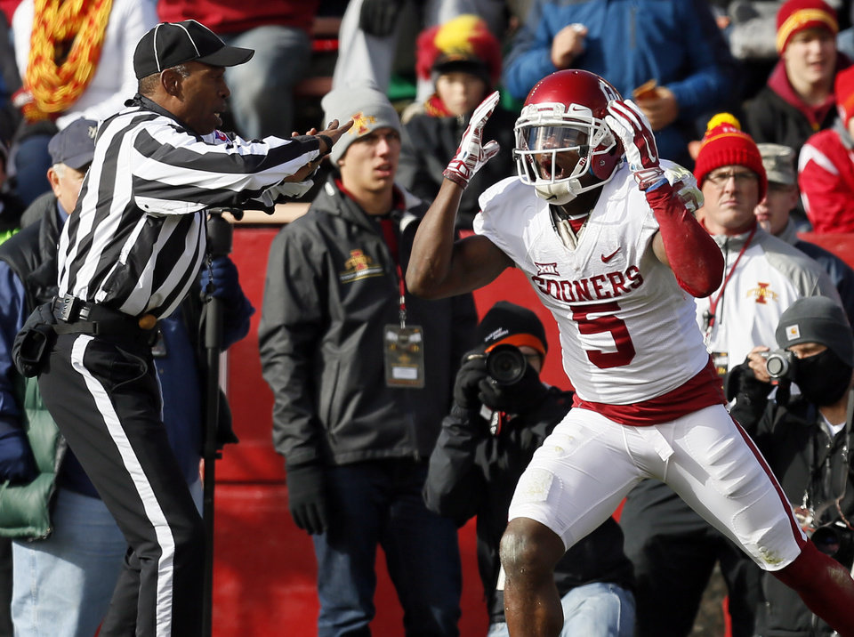 Photo - Oklahoma's Durron Neal (5) reacts after officials ruled that he did not have possession of the ball when he attempted a catch in the end zone in the first quarter during a college football game between the University of Oklahoma Sooners (OU) and the Iowa State Cyclones (ISU) at Jack Trice Stadium in Ames, Iowa, Saturday, Nov. 1, 2014. Photo by Nate Billings, The Oklahoman