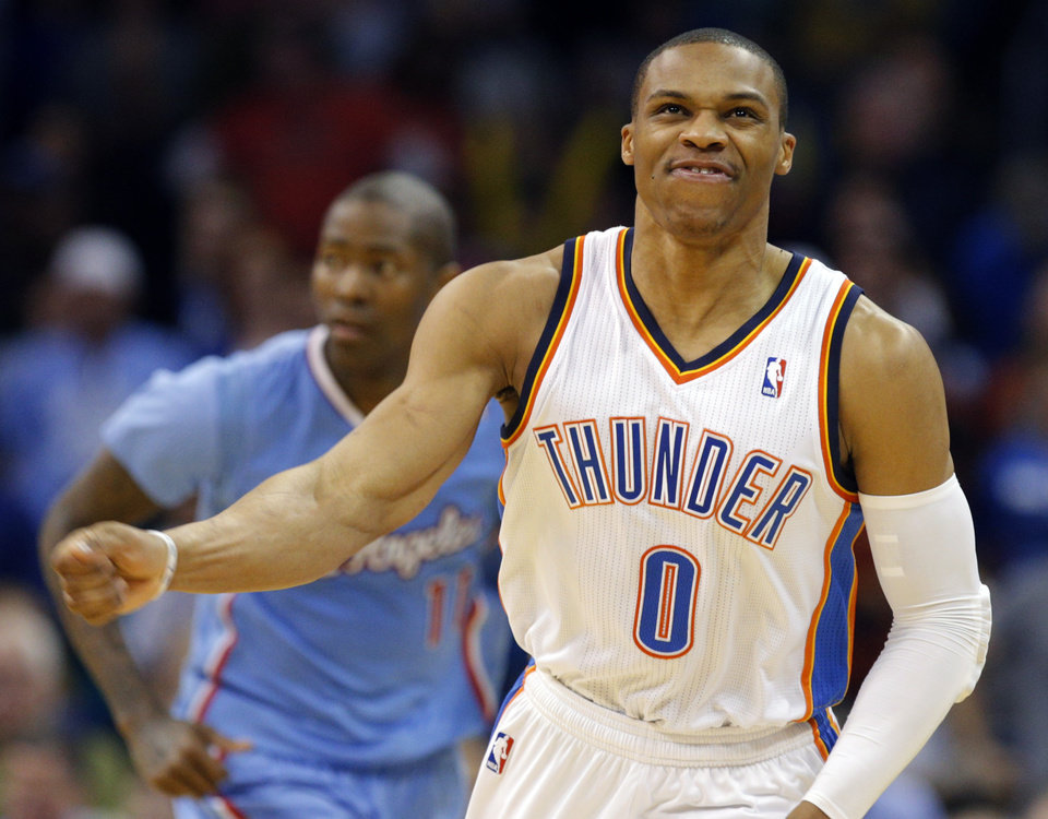 Photo - Oklahoma City 's Russell Westbrook (0) reacts to a miss shot during the NBA game between the Oklahoma City Thunder and the Los  Angeles Clippers at the Chesapeake Energy Arena, Sunday, Feb. 23, 2014. Photo by Sarah Phipps, The Oklahoman
