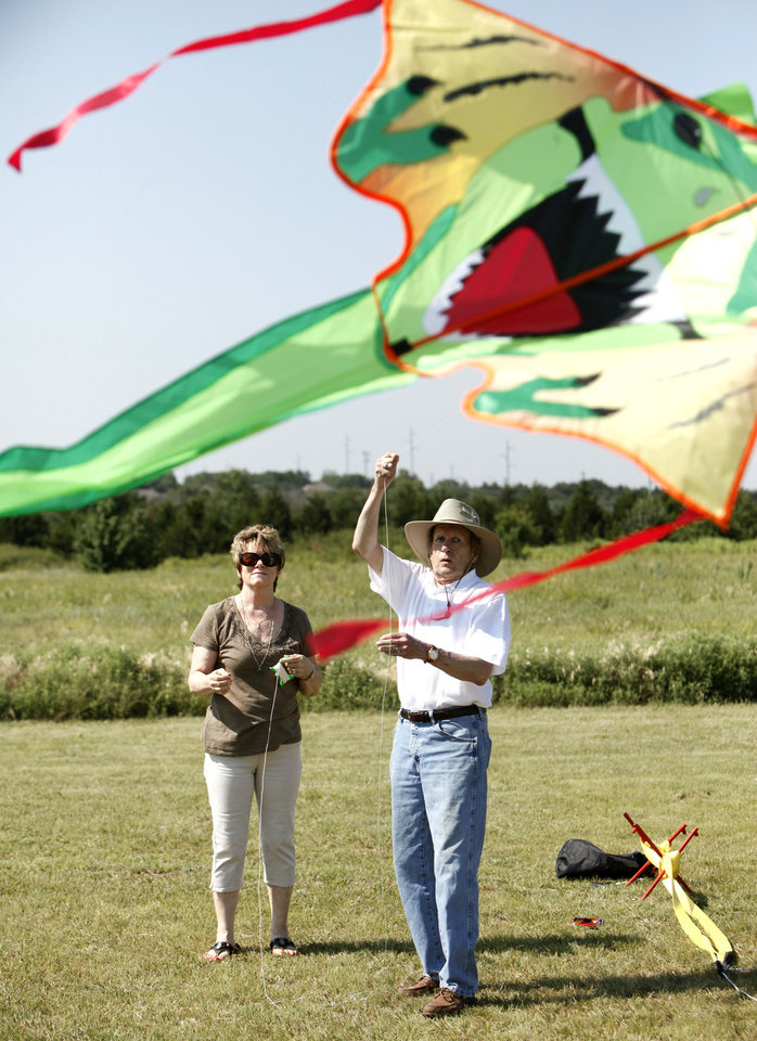 Photo - Janelle and Charlie Cox fly a large kite Saturday during KiteFest.