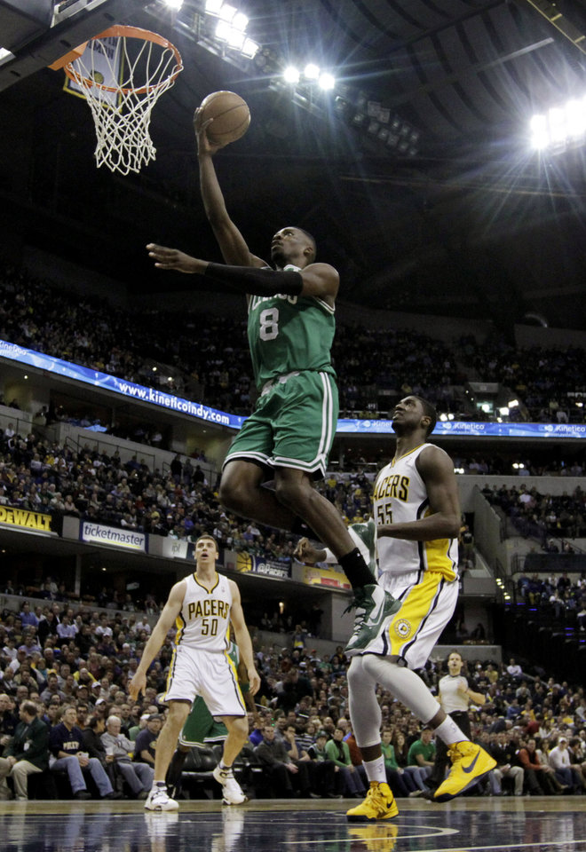 Boston Celtics' Jeff Green (8) goes up for a shot against Indiana Pacers' Roy Hibbert (55) during the first half of an NBA basketball game Wednesday, March 6, 2013, in Indianapolis. (AP Photo/Darron Cummings)