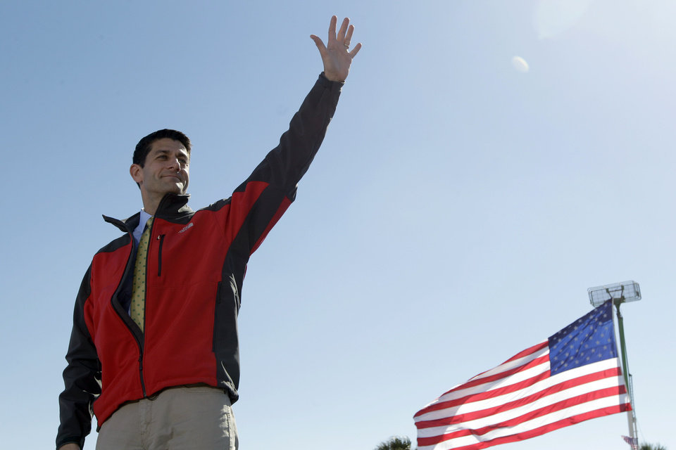 Photo -   Republican vice presidential candidate, Rep. Paul Ryan, R-Wis., waves at supporters during a campaign event, Monday, Oct. 29, 2012 in Fernandina Beach, Fla. (AP Photo/Mary Altaffer)