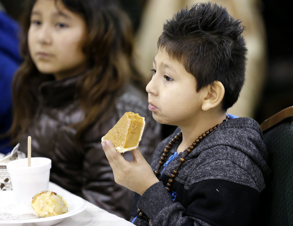 Photo -  Juan Maldanodo, 5, eats pumpkin pie during the dinner. [Photo by Steve Sisney, The Oklahoman]