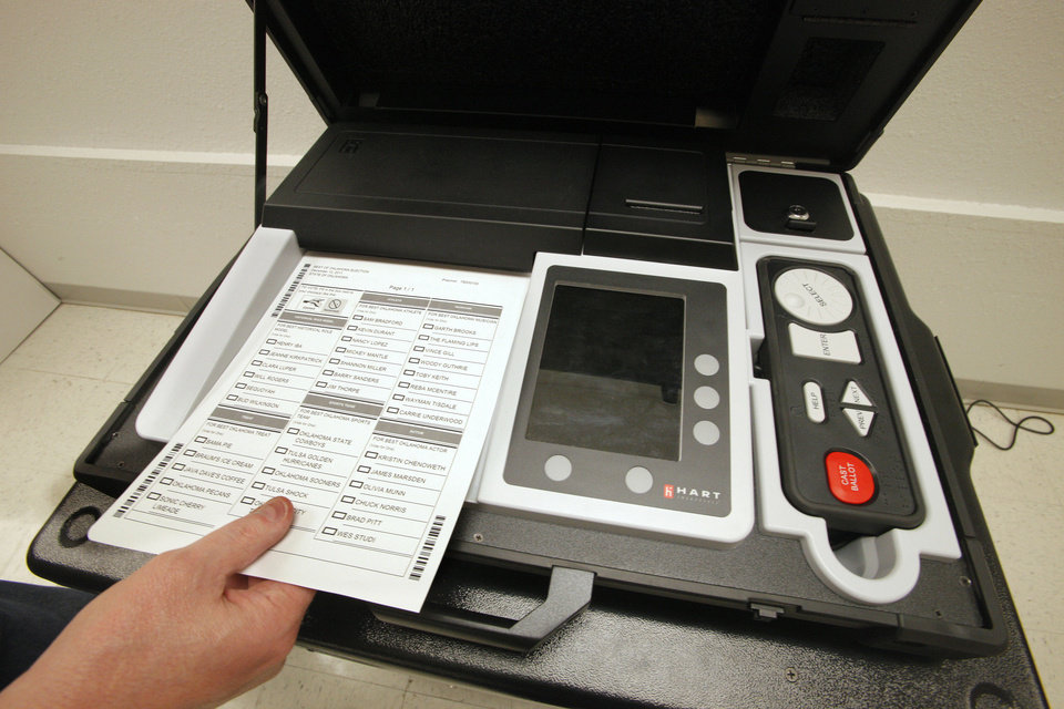 Photo - Oklahomans will have the opportunity this week to cast ballots with new election devices. They will be on display at county election board offices across the state. PHOTO BY PAUL B. SOUTHERLAND, THE OKLAHOMAN