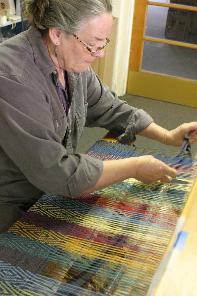 "Donna Hilton weaving strips of cloth through the ""warp"" for her colorful rag rug.<br/><b>Community Photo By:</b> Bob Bozarth<br/><b>Submitted By:</b> Sue, Guthrie"