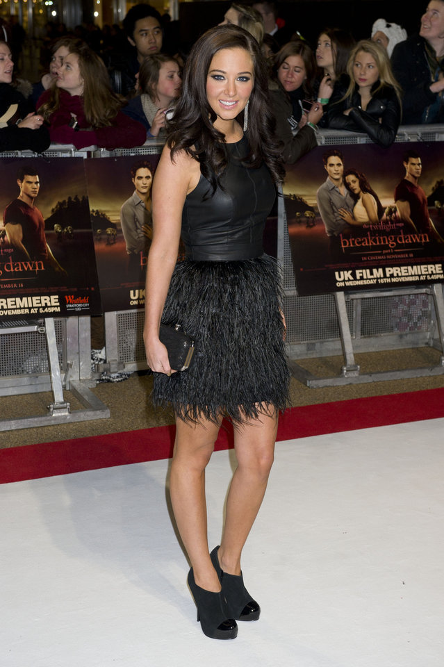 British singer Tulisa Contostavlos arrives for the UK premiere of 'Twilight Breaking Dawn Part 1' at a central London venue,  Wednesday, Nov. 16, 2011. (AP Photo/Jonathan Short) ORG XMIT: LJS119