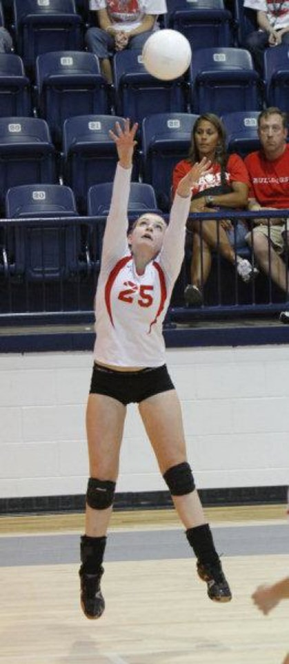 Photo - Oklahoma Christian's Emily Belz sets up the ball for a teamate as they play against Cache in the Class 4A State Volleyball tournament at at Shawnee High School in Shawnee, OK, Friday, Oct. 7, 2011. By Paul Hellstern, The Oklahoman ORG XMIT: KOD