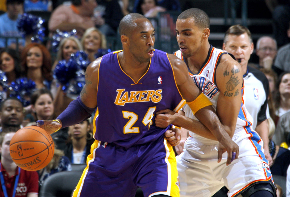 Photo - Oklahoma City's Thabo Sefolosha (2) guards Lakers' Kobe Bryant (24) during the NBA basketball game between the Oklahoma City Thunder and the Los Angeles Lakers, Sunday, Feb. 27, 2011, at the Oklahoma City Arena.Photo by Sarah Phipps, The Oklahoman