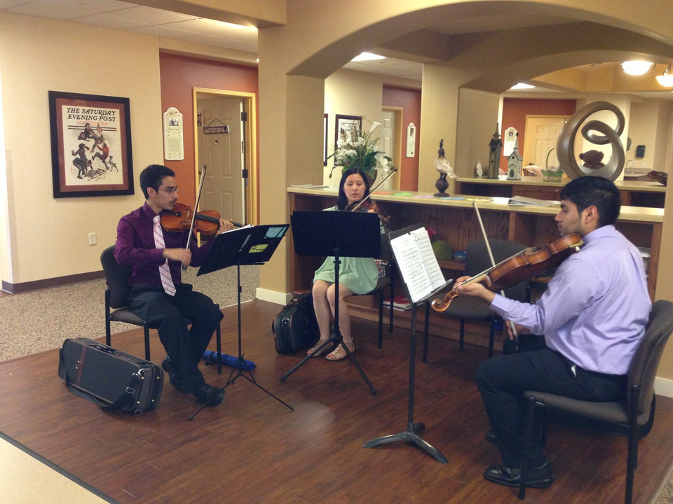 Music therapy important for those with dementia. UCO students Jose Batty, Angela Qi, Orlando Ramirez at Touchmark\'s memory-care community