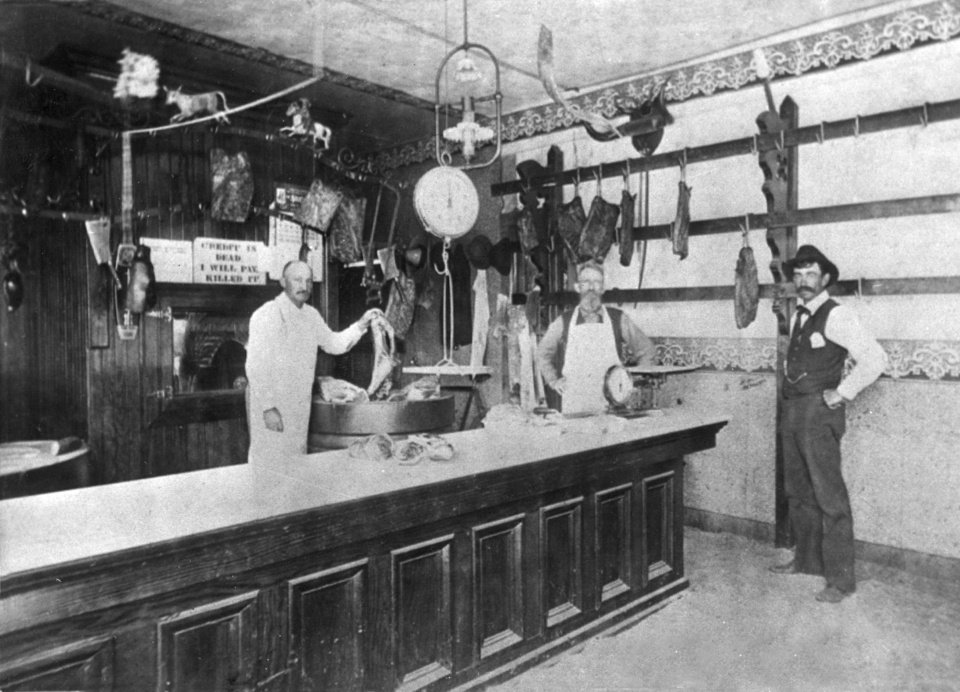 H.C. Schilling holds a beef shank in this 1898 photograph inside a butcher shop on Broadway in Oklahoma City.