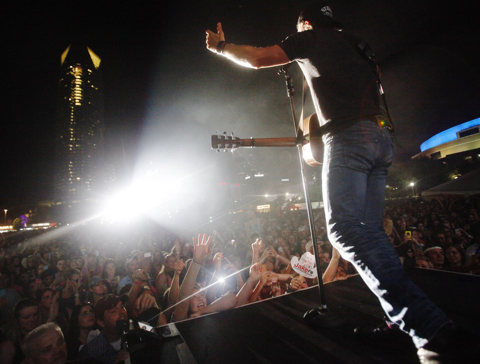Photo - Country artist Dierks Bentley performs the headlining set at OKC Fest in downtown Oklahoma City on Friday, June 27, 2014. OKC Fest is a new two day country music festival with multiple stages downtown. Photos by KT King/The Oklahoman