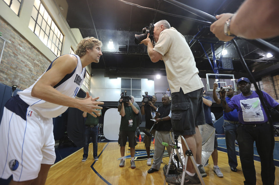 Dallas Mavericks' Dirk Nowitzki, left, of Germany, poses for photos during the NBA basketball team's media day Friday, Sept. 28, 2012, in Dallas. Nowitzki again has a lot of new teammates with the Mavericks. For the second year in a row, this time after being swept out of the playoffs instead of winning the NBA title, the Mavs have drastically altered their roster. (AP Photo/LM Otero)