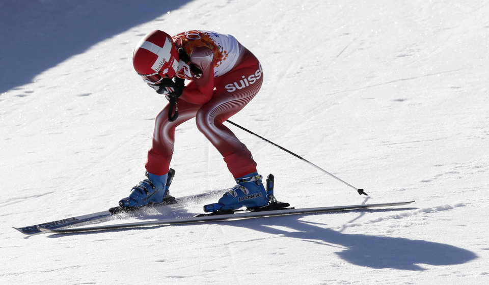 Photo - Switzerland's Dominique Gisin reacts after finishing the women's downhill at the Sochi 2014 Winter Olympics, Wednesday, Feb. 12, 2014, in Krasnaya Polyana, Russia. Gisin tied with Slovenia's Tina Maze to win the gold medal. (AP Photo/Christophe Ena)