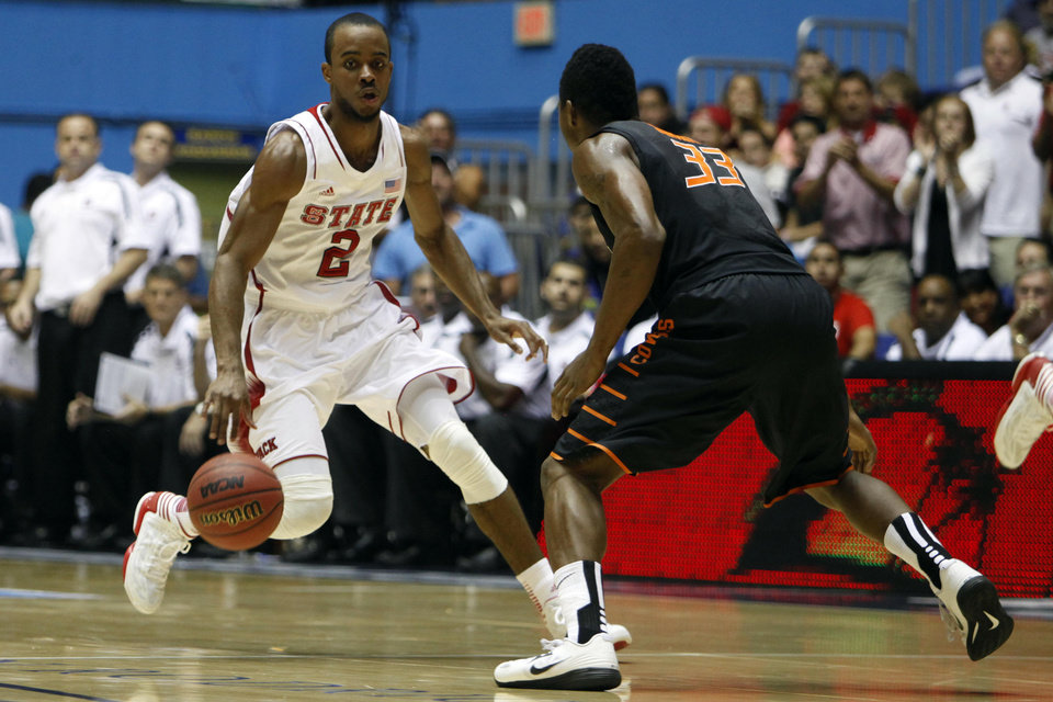 NC State�s Lorenzo Brown, left, drives the ball against Oklahoma State�s Marcus Smart during a NCAA college basketball game in Bayamon, Puerto Rico, Sunday, Nov. 18, 2012. (AP Photo/Ricardo Arduengo)