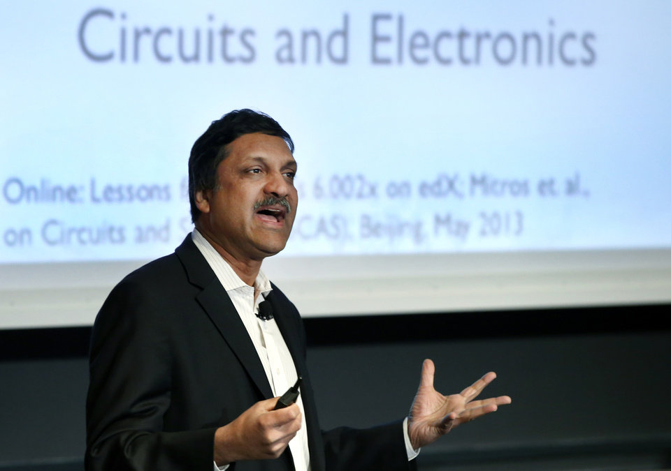 Photo - Anant Agarwal, president of edX, an online learning platform, speaks at the Massachusetts Institute of Technology in Cambridge, Mass., Monday, March 3, 2014 about