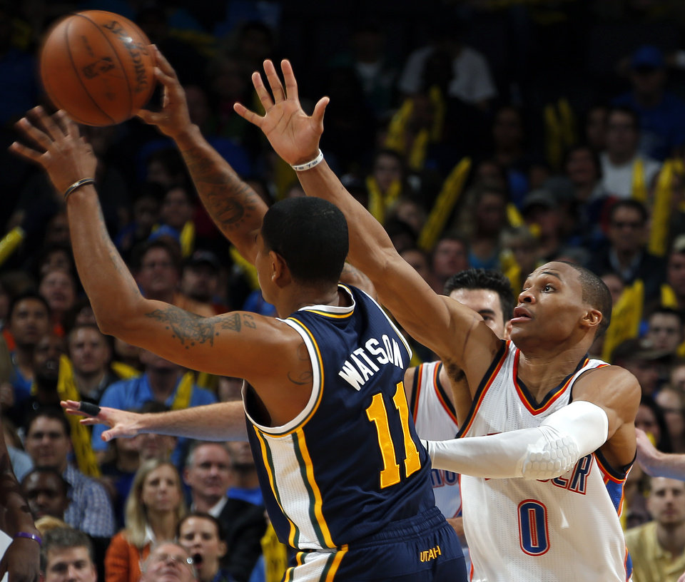 Oklahoma City\'s Russell Westbrook (0) defends against Utah\'s Earl Watson (11) during the NBA game between the Oklahoma City and the Utah Jazz and the Chesapeake Energy Arena, Friday,Nov. 30, 2012. Photo by Sarah Phipps, The Oklahoman