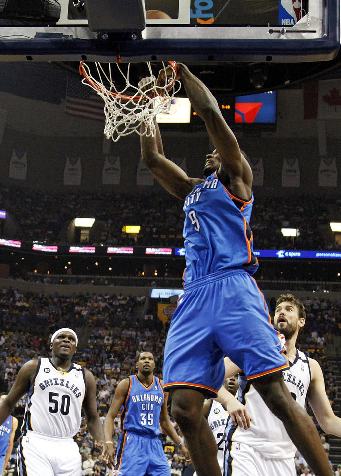 Photo - Oklahoma City's Serge Ibaka (9) misses a dunk in front of Memphis' Zach Randolph (50), Oklahoma City's Kevin Durant (35) and Memphis' Marc Gasol (33) in the first half of Game 3 in the second round of the NBA basketball playoffs between the Oklahoma City Thunder and Memphis Grizzles at the FedExForum in Memphis, Tenn., Saturday, May 11, 2013. Photo by Nate Billings, The Oklahoman