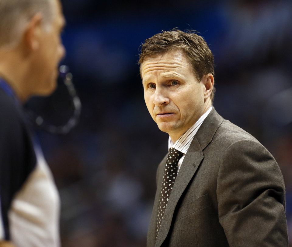 Photo - Thunder coach Scott Brooks looks at an official during an NBA basketball game between the Oklahoma City Thunder and the Sacramento Kings at Chesapeake Energy Arena in Oklahoma City, Monday, April 15, 2013. Photo by Nate Billings, The Oklahoman